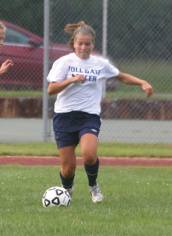 GIVING CHASE: Toll Gate's Emily Fox closes in on the ball during Saturday's tournament at Warwick Vets.