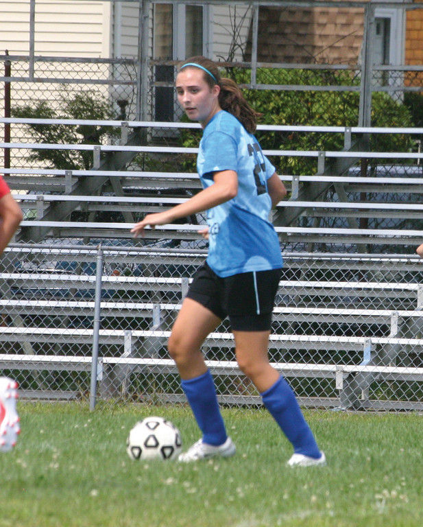 Emily Almonte looks upfield for someone to pass to.