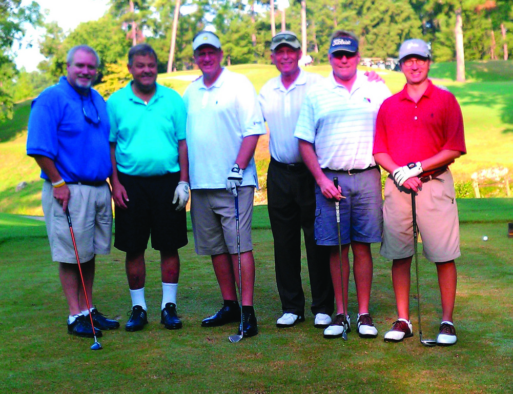 ALL TOGETHER: Mike McKone stands with his friends on the tee during a 2011 Pro-Am.