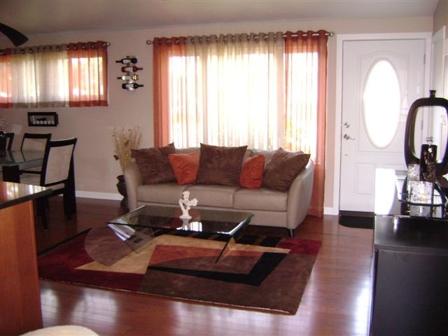 HOW IT'S CHANGED: The living room in the wake of Irene and as it is today.