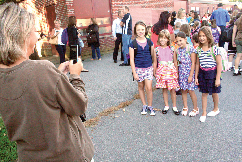 Diane Brannon snaps a photo of third grade classmates and friends, from left: Hannah Maguire, Annaliese Brannon , Lily Bastia and Alexandra Carter.
