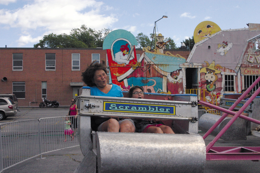 SCRAMBLER: Suzie Healy and Elizabeth Lamoureux, 9, of West Warwick enjoy a spin on the Scrambler.