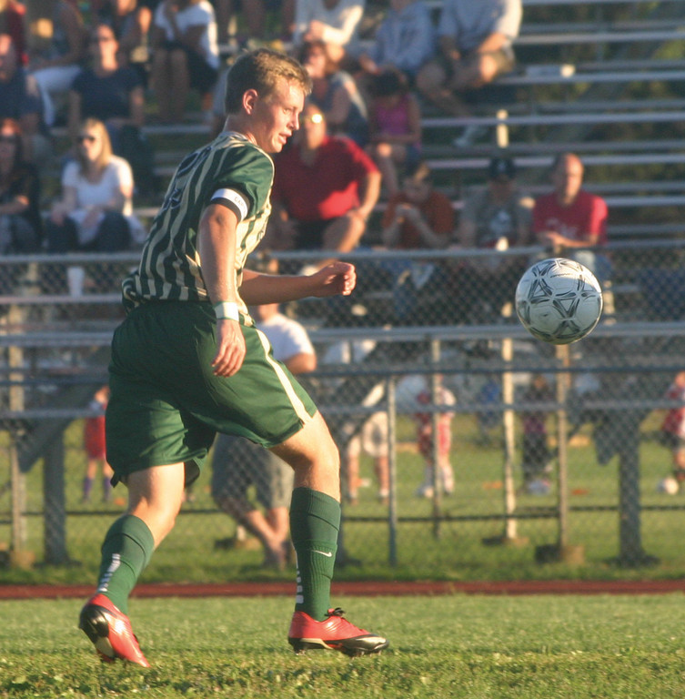 KEEPING IT CLOSE: Hendricken's Dan Levesque tries to corral a bouncing ball.