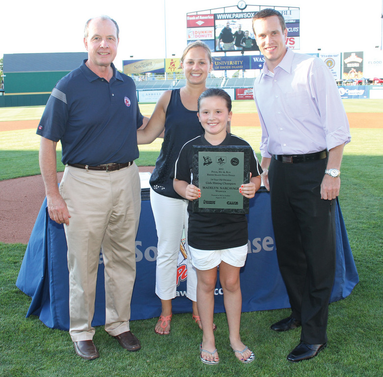 WINNING: Pictured left to right: Mike Tamburro, President, Pawtucket Red Sox; Molly Burt, Associate Field Marketing Manager, Dunkin' Donuts; Madelyn Narcavage, Hitting champion for the 7-8 year old division; and Sean Sullivan, Account Executive for CW 28.