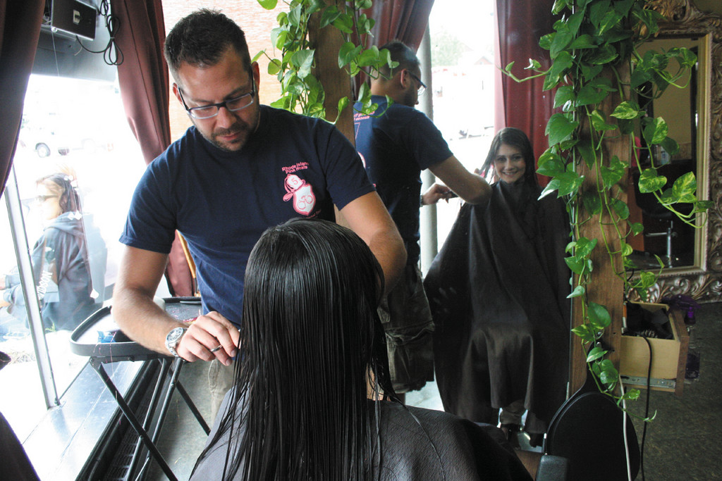 ONE OF MANY: Niessen Schiller trims and styles the hair of Cheyanne Boucher during Sunday's daylong event to raise funds for Rhode Island Pink Heals.