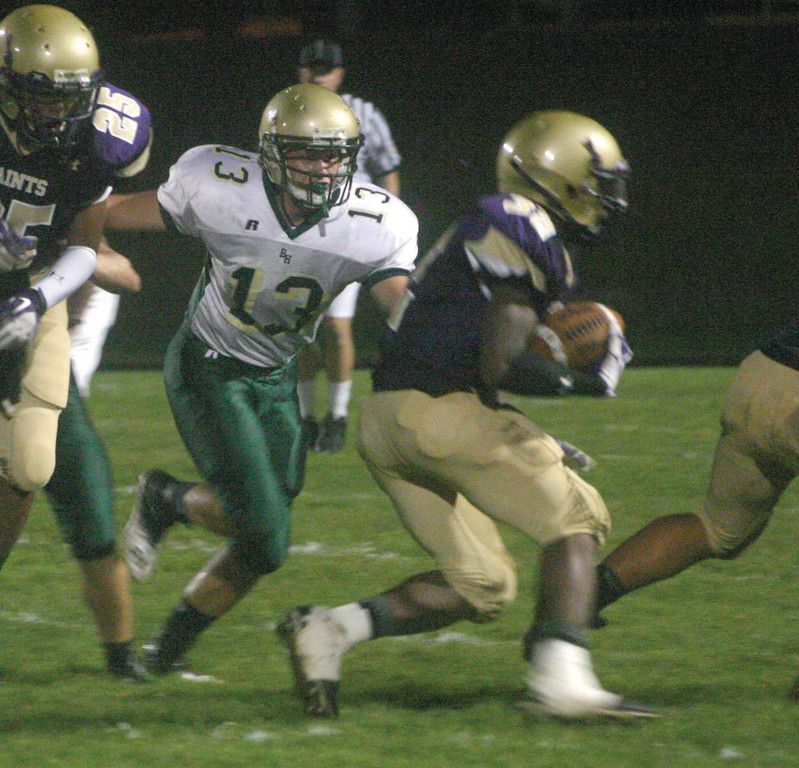 BEARING DOWN: Hendricken's Brandon Kenyon pursues Alfred Dorbor in Friday's non-league season opener.
