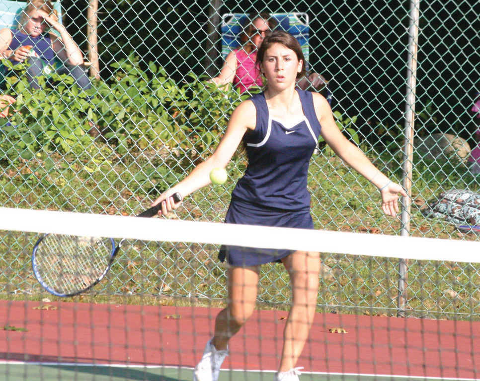 FOREHAND: Toll Gate's Jackie Falso hits a shot at No. 2 doubles during Friday's match against Ponaganset. The Titans beat the defending D-III champions 7-0 to get their season off to a strong start.