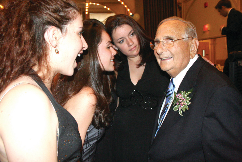 HIS MANY ADMIRERS: An estimated 1,000 people including these former students turned out to wish Robert Shapiro well in his retirement at a party held in June, 2007.