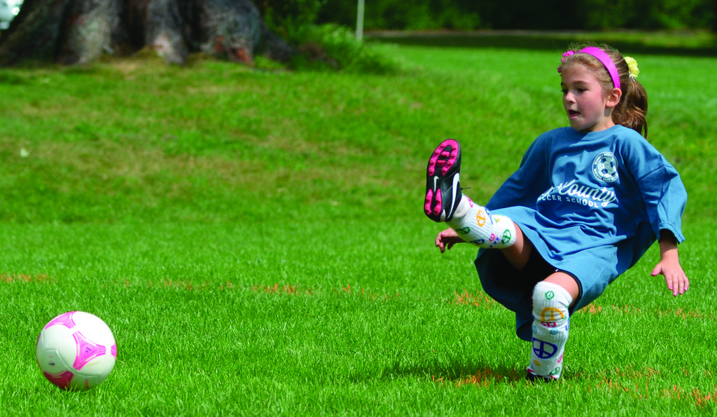 Aleah Dickson takes a big kick during a game at Warwick Soccer Association opening day on Saturday.