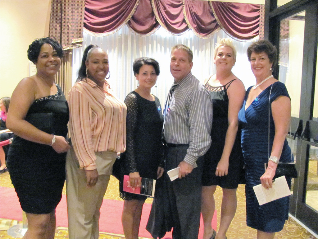SUPPORT STAFF: Among those Saint Elizabeth Community staffers who were on hand to greet guests at last Friday evening�s Rose Bids goes to Hollywood Fundraiser in Warwick are, from left: Juanita Barber, Kim Guenette, Maggie Connelly, Ken Cote, Jennifer Marshalsea and Louise Robillard.