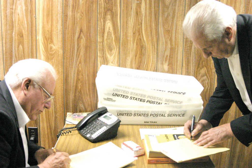 GETTING THE NUMBERS: Current Ward 8 Councilman Ray Gallucci (left) helps his brother.