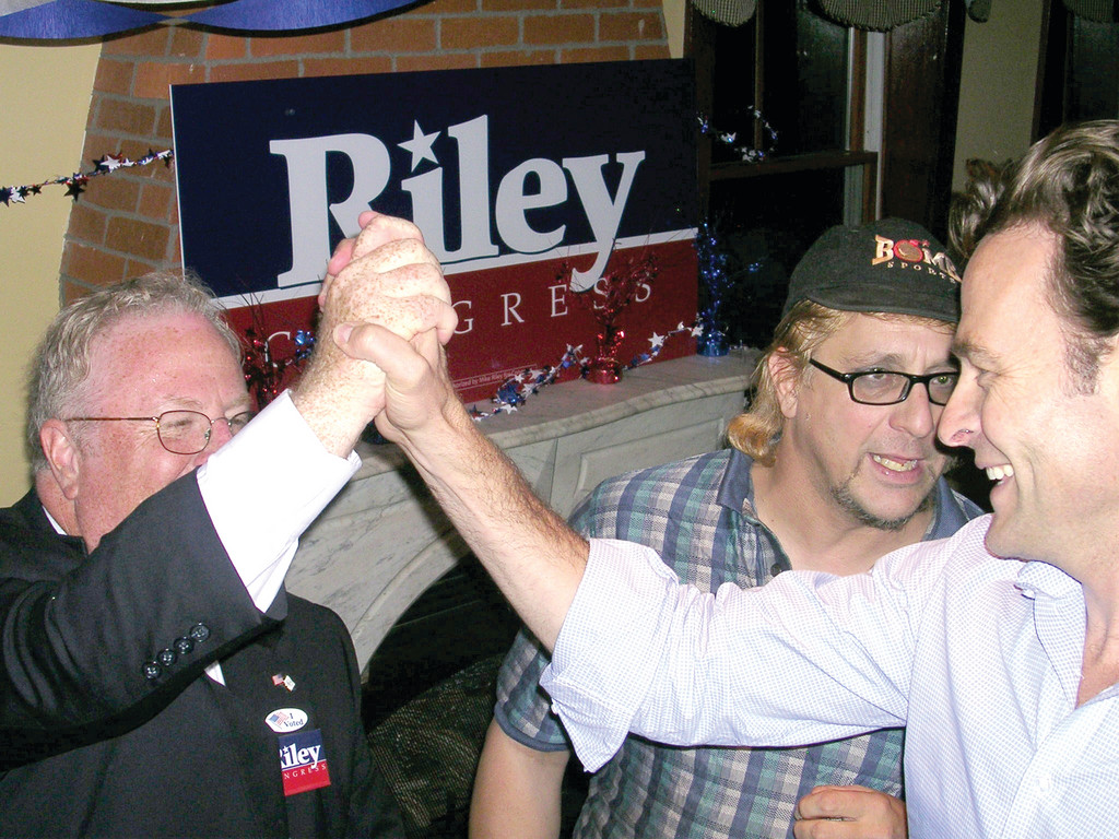 VICTORY: Republican Congressional District 2 candidate Michael Riley (at left) high-fives Republican Senate candidate Barry Hinkley at a party at O�Rourke�s Tavern in Warwick on Tuesday night. Riley earned a place on the November ballot with 65 percent of the vote in Tuesday�s primary election. He beat out fellow Republicans Kara Russo, Michael Gardiner and Don Robbio.