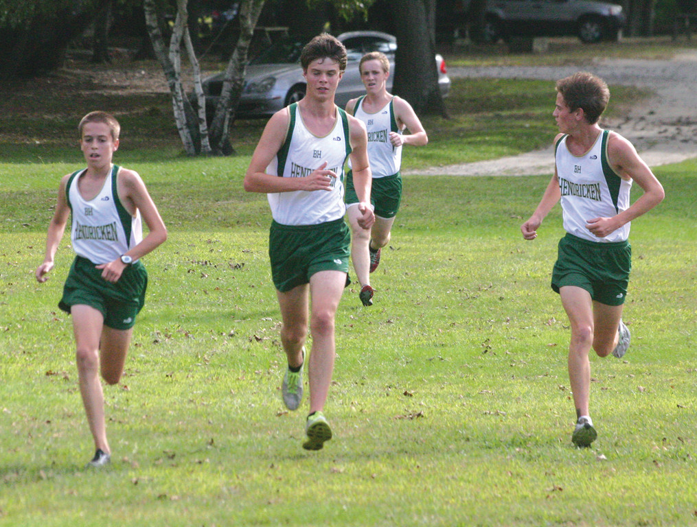 ON THE MOVE: From left: Hendricken's Greg Beaudette, Colin Tierney, Collin Manning and Connor Doyle head for the finish line in Monday's season-opening dual meet at Goddard Park.