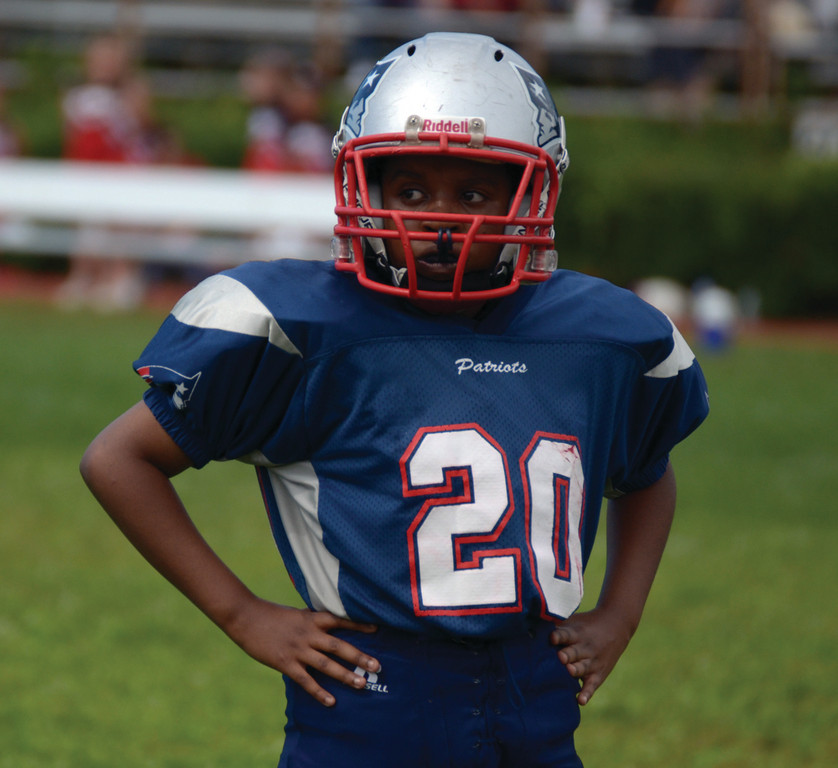 TAKING THE FIELD: The PAL PeeWees were also in action Sunday. Here, Miko Williams waits for a play.