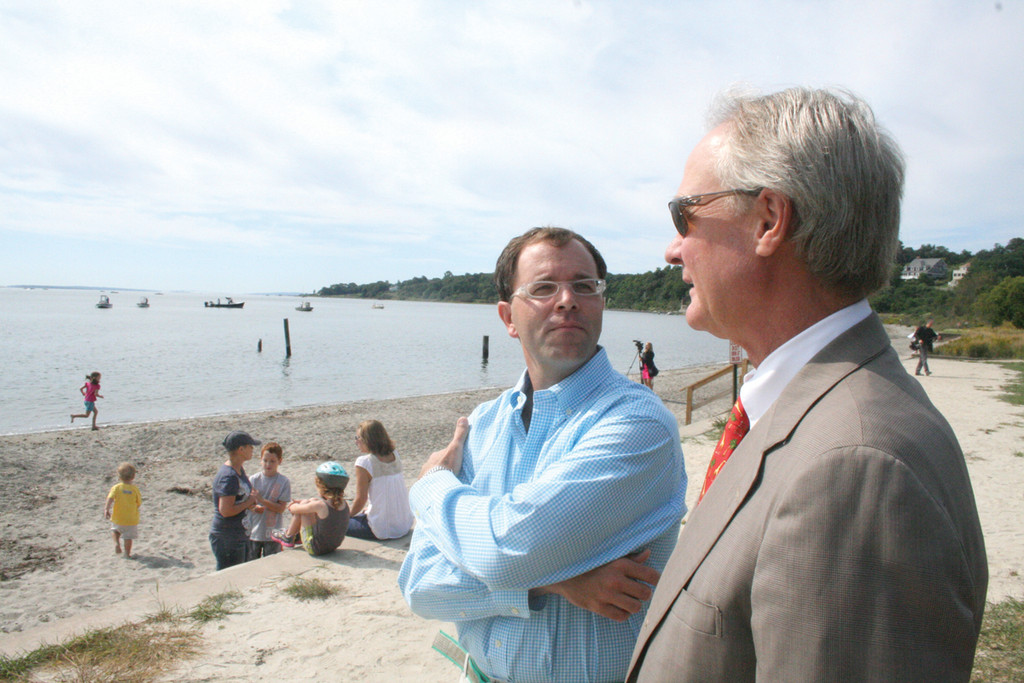 A HAPPENING PLACE: George Shuster of the Rocky Point Foundation and Governor Chafee speak following yesterday's announcement that the state has reached an agreement with the SBA to acquire the remaining 80 acres of the defunct park.