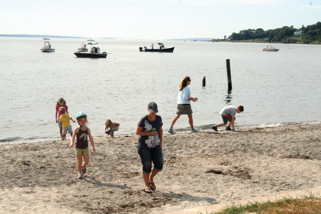 Families enjoy the shoreline at Rocky Point.