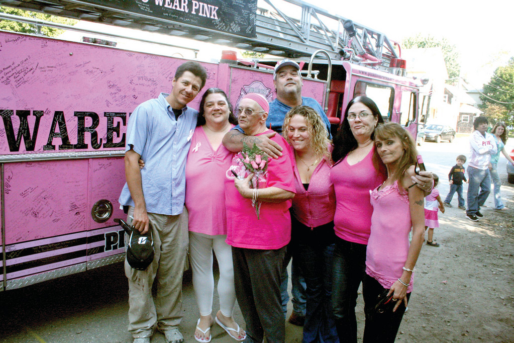 ALL HER FANS: Kathy Adams is surrounded by family and friends as a Pink Heals fire truck visits her home in Hillsgrove.