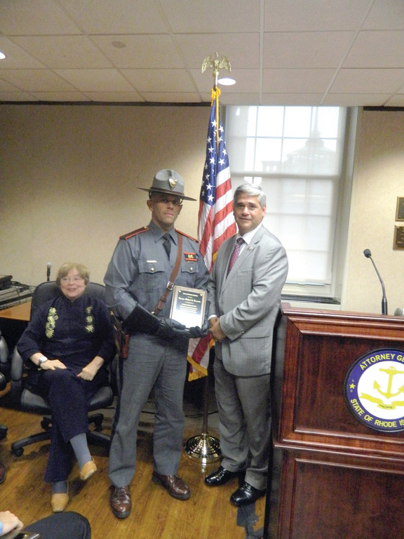 HONORED WITH AWARD: RI State Police Trooper Ferruccio (left) receives the Justice Award for Law Enforcement from Attorney General Peter Kilmartin.