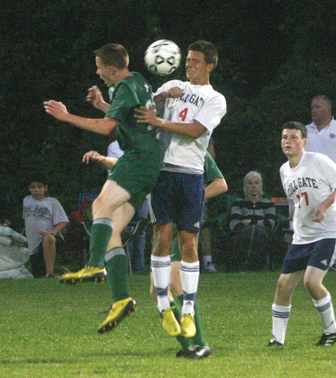 JUMP AROUND: Josh Sandin tries to win a ball against a Smithfield player during Thursday's game.