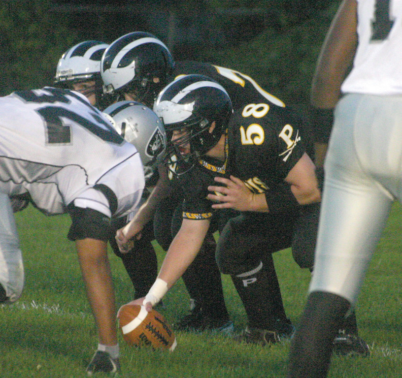 LINED UP: Pilgrim center Austin Lemire gets set to snap the ball during Friday's game against Shea. The Pats trailed 35-0 before the game was called due to a field problem.