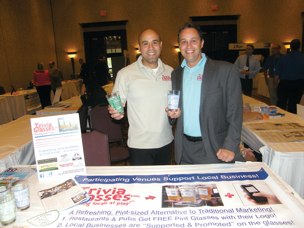 TRIVIA GLASSES: Richard Nuttall (right) started Trivia Glasses about six months ago, and has already struck deals with restaurants in South County and Warwick. He is pictured here with Johann Polo, VP of Latino Sales, at their booth at the �We Mean Business� Expo.