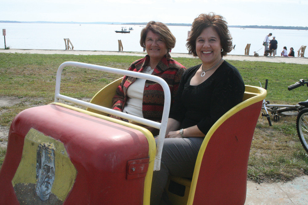 LIKE THE GOOD OLDE TIMES: Chris Allen and Maria Puleo of the Central Rhode Island Chamber remember the good times as they sit in one of the rides that was on display for Monday's announcement that the state and the SBA have reached an agreement on the sale of Rocky Point Park.