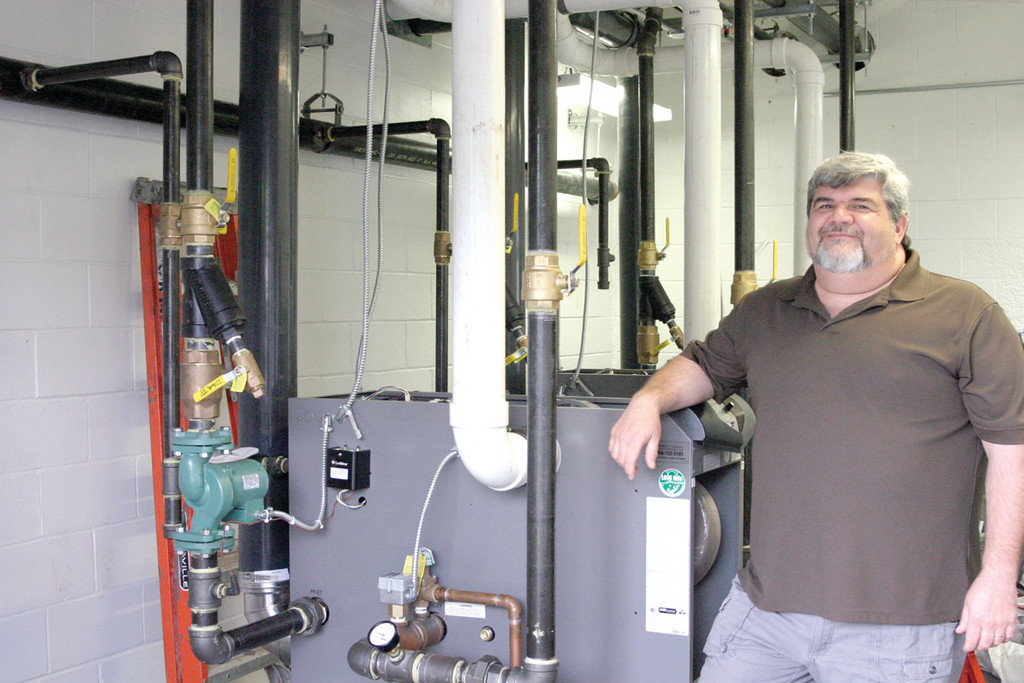 NEW BOILERS: Jim Dorney, facilities manager of McDermott Pool and Thayer Arena, said he anticipates the new boiler system will provide substantial savings for McDermott. The boilers heat the entire facility, including two pools.