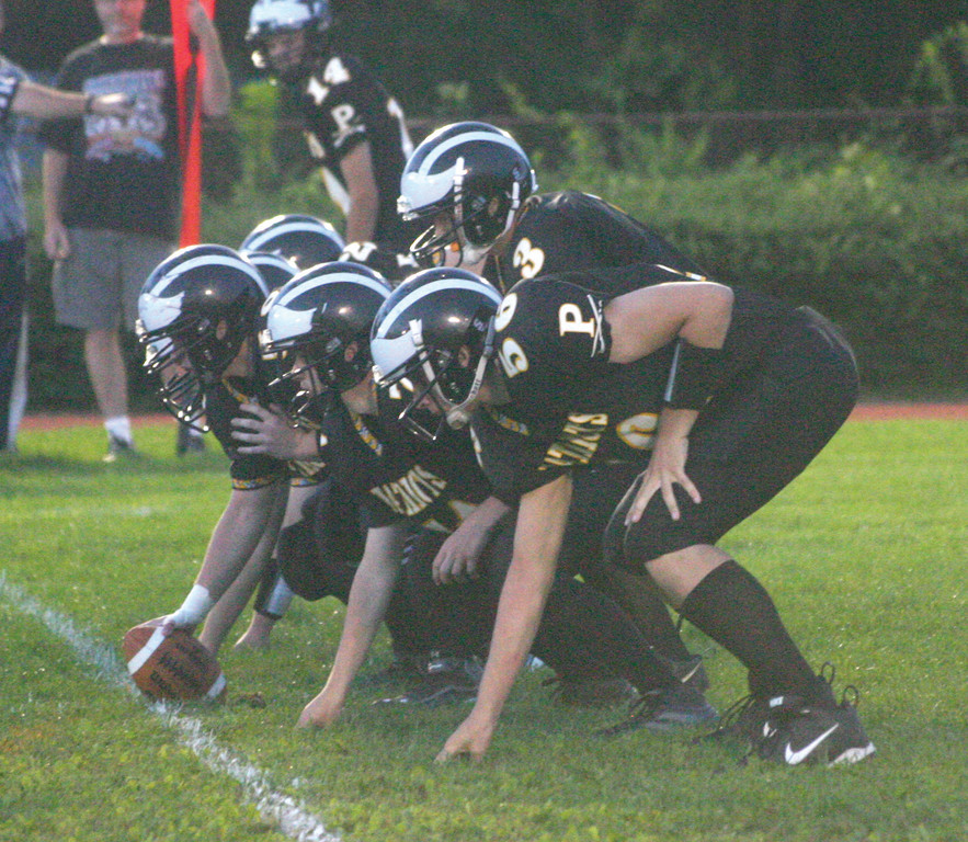 LINED UP: Pilgrim's offensive line and quarterback Rob Quaine get set for a snap in last week's game.