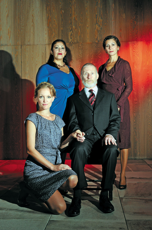 Trinity Rep resident acting company favorite Brian McEleney stars as the aging monarch King Lear who has decided to split his kingdom among his three daughters —standing left to right — Goneril (DTC resident actor Christie Vela), Regan (TRC resident actor Angela Brazil), and (foreground) Cordelia (DTC's Abbey Siegworth) —with the largest share going to the daughter who loves him best. Shakespeare's sweeping tragedy King Lear is a co-production with The Dallas Theater Center (DTC) directed by DTC artistic director Kevin Moriarty. Sept. 13 through Oct. 21 in the Dowling Theater, Trinity Repertory Company. Set design by Michael McGarty, costume design by William Lane, and lighting design by Seth Reiser.