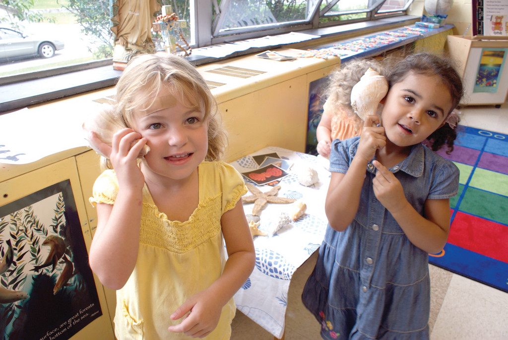 SEA SOUNDS: Three-year-old Chloe Fielding and 4-year-old Aliyah Rose learn about the sea in the pre-K program at St. Kevin School. The program started this year has an enrollment of 44.