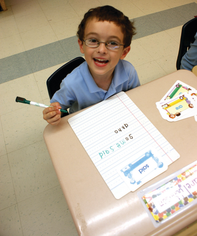 WRITING ALREADY: St. Kevin School kindergartner James Kregler works on his writing.