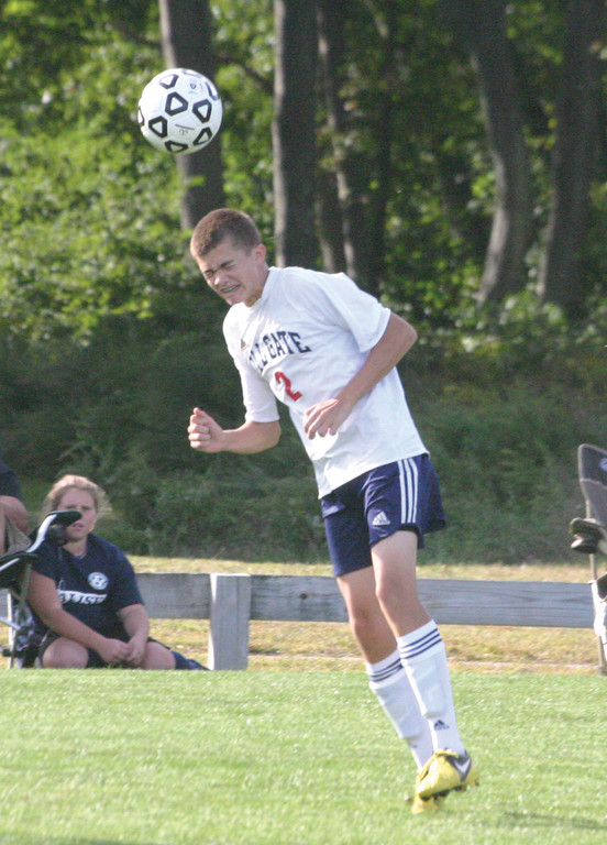 DOING IT ALL: Toll Gate's Andrew Rocchio sends a header.