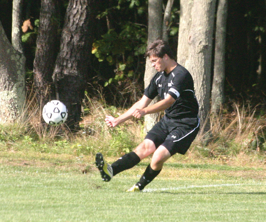 FIRE AWAY: Pilgrim's Christian White takes a goal kick during Thursday's showdown with Toll Gate.
