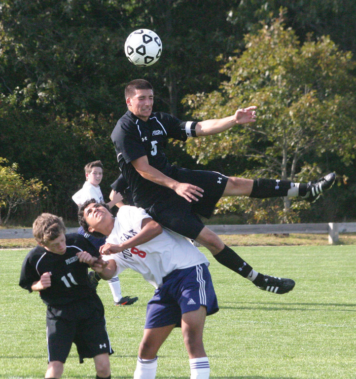 CLIMBING: Pilgrim's Jordan DeSisto leaps high for a header over Toll Gate's Jose Beltran in Thursday's game. The Pats picked up their first win of the season.