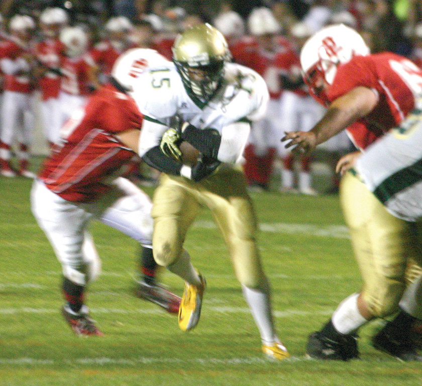 TO THE END ZONE: Power Kanga slips through the line on his 12-yard touchdown run in Friday's win over EP.