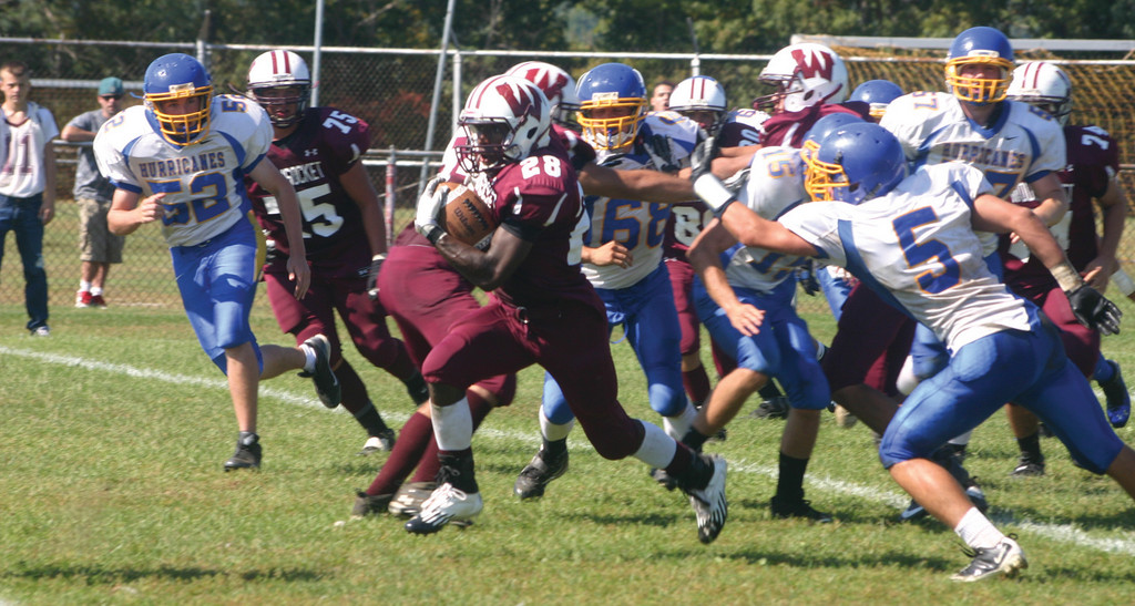 CAUGHT UP: Woonsocket's Jalen Evans breaks away from the Vets defense in Saturday's game.