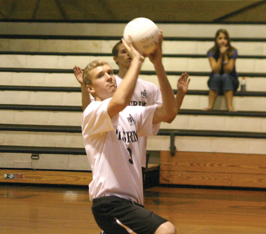 Brendan Rix sets the ball for a teammate.