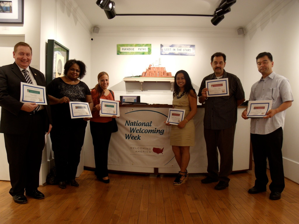 OFFICIALLY WELCOMED: First- and second-generation American members of Welcoming Rhode Island show off certificates thanking them for their participation in a kick-off campaign for the grass-roots organization. They are, from left, Patrick Griffin, Mercedes Monetiro, Manuela Raposo, Silaphone Nhongvongsouthy, Bruno Sukys and Haruki Kibe.