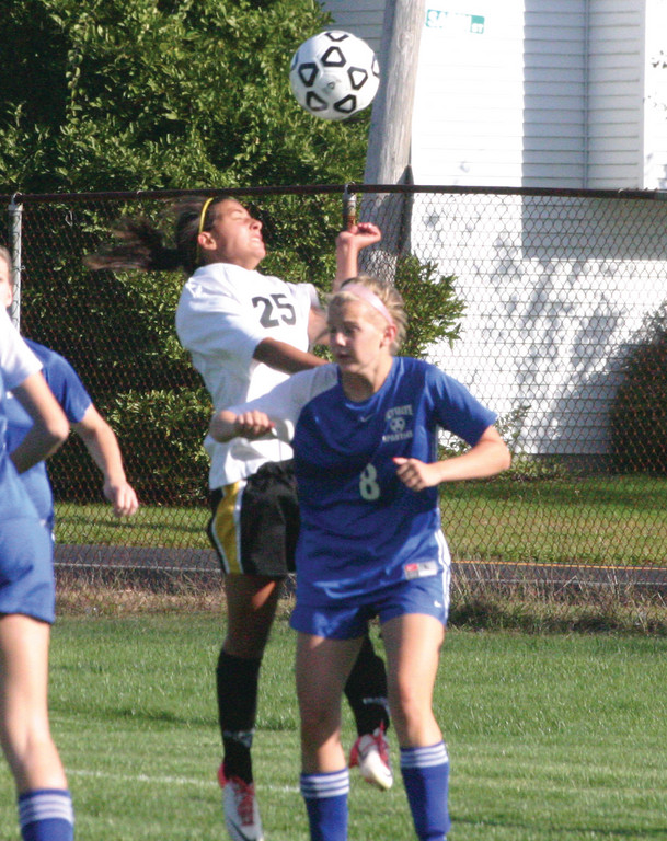 GOING UP: Pilgrim's Katie Viera gets up for a header in Tuesday's game against Scituate. The Pats won 4-2.