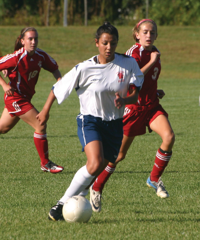 Karina Santos carries the ball up the field for the Titans, who won 4-2 for their second consecutive victory.