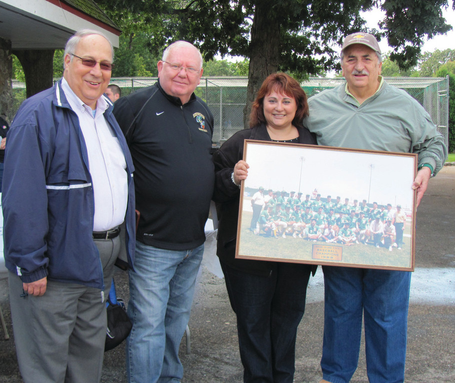 "SALUTE: The ""Coach Val"" Innocente Fundraiser held Saturday in Roger William Park attracted many of the former Hendricken coach's colleagues and friends. Above, former Hawk head basketball coach Steve Ceseretti, who also coached baseball at the Warwick school, holds a picture of one of their state championship teams. The group also includes Tony Leone, Bob Stephens and Chairperson Lori Mello."