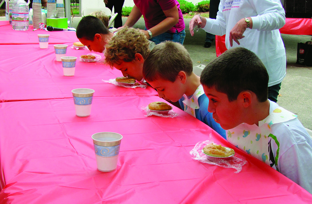 Pictured are past contestants in the Apple Pie Eating Contest.