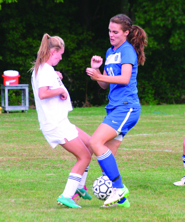 CLOSE QUARTERS: Katie Gregory battles a Bay View player for possession in Thursday's game. The 'Canes fell behind early and never recovered in an 8-0 loss, their seventh in a row.