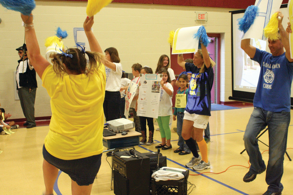 SUPER CHEERLEADER: Fourth grade teacher Susan Fusco (back to camera) kept everyone bouncing with her energy.