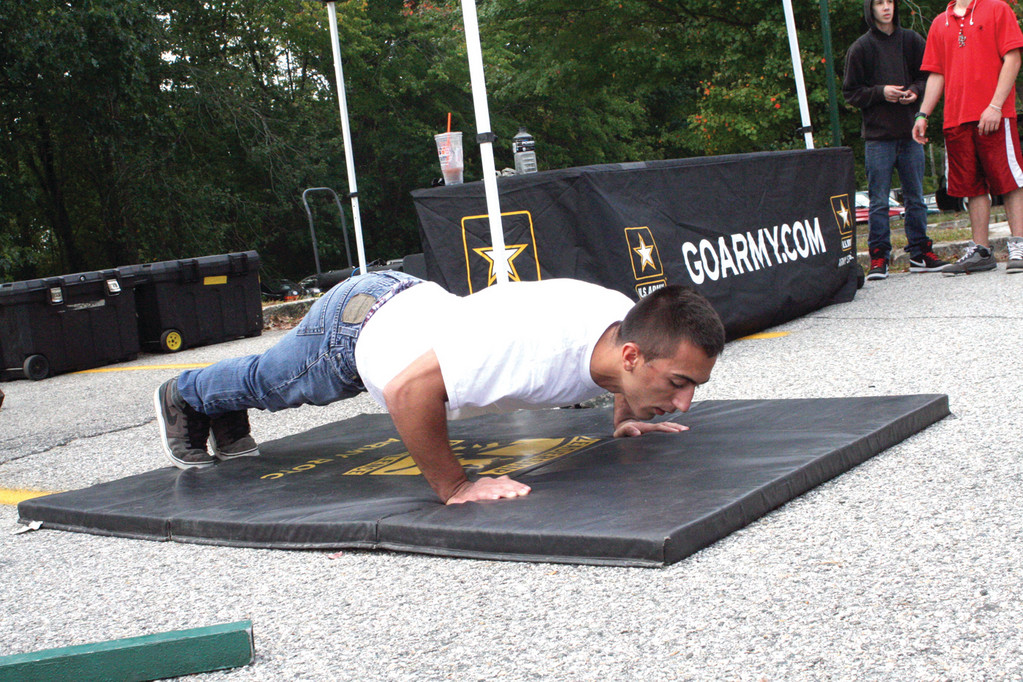 KEEPING COUNT: Student John Digiuseppe had the admiration of his peers as he performed 60 pushups. He is thinking the military might be a good career path.
