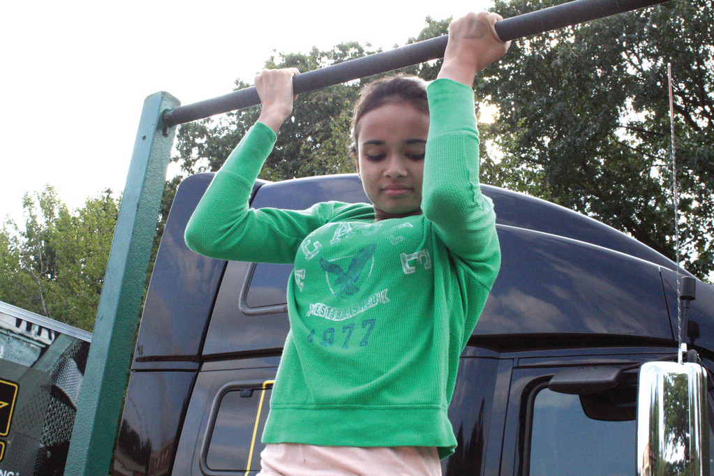ONE IS BETTER THAN NONE: Toll Gate freshman Hannah Simas found the chin-up bar a challenge, one some of her classmates weren't willing to take.