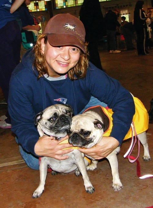 PUGGLE TROUBLE: Patti Elderkin of Warwick poses with her pugs, Abby and Jax.