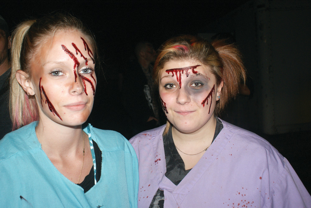 ZOMBIE ATTACK: Playing victims from zombie attacks are Amanda Healy and Ashley Pincince at Tours of Terror.