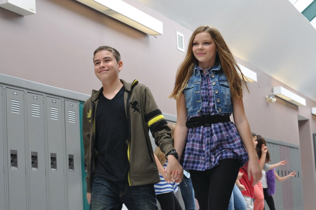 INSPIRATIONAL: Through music, Susie Shannon, 11, a sixth grader at Hoxsie Elementary School, wants to combat bullying. She recently wrote a song, �Inspirational,� and recorded an accompanying video at various locations in Warwick, including the halls of Hendricken, as shown in this scene with Joey Mcaughey, a dancer from Triple Threat Performing Arts Center.
