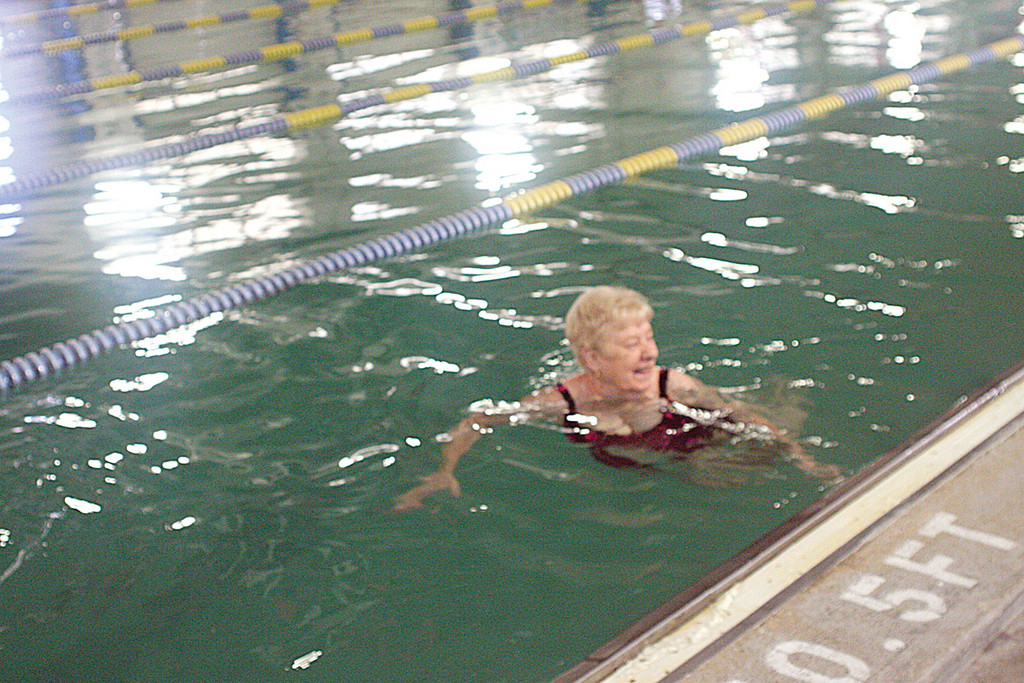 DIFFERENT STROKES: The fact that pool water is green due to a leaky heat exchanger doesn�t stop Crystal Carney of Warwick from going for a swim. It was her first swim at McDermott.